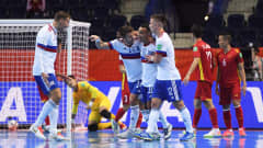 VILNIUS, LITHUANIA - SEPTEMBER 22: Robinho of Football Union of Russia celebrates after scoring their sides first goal with team mates Danil Davydov and Ivan Chishkala during the FIFA Futsal World Cup 2021 Round of 16 match between Football Union of Russia and Vietnam at Vilnius Arena on September 22, 2021 in Vilnius, Lithuania. (Photo by Alex Caparros - FIFA/FIFA via Getty Images)