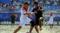 RAVENNA, ITALY - SEPTEMBER 08: Yury Gorchinskiy of Russia challenges Morgan Plata of Mexico during the FIFA Beach Soccer World Cup Quarter Final match between Russia and Mexico at Stadium del Mare on September 8, 2011 in Ravenna, Italy. (Photo by Lars Baron - FIFA/FIFA via Getty Images)