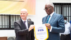 FIFA President Gianni Infantino poses for a photo with Minister of Sport Hugues Ngouélondélé at Brazzaville's FIFA Regional Development Office inauguration