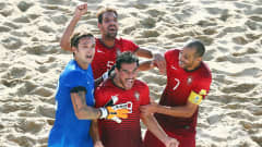 ESPINHO, PORTUGAL - JULY 19:  Bruno Novo (C) of Portugal celebrates his team's fourth goal with team mates Andrade (L), Jordan (back) and Madjer during the FIFA Beach Soccer World Cup Portugal 2015 Final between Tahiti and Portugal at Espinho Stadium on July 19, 2015 in Espinho, Portugal.  (Photo by Alex Grimm - FIFA/FIFA via Getty Images)