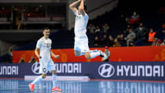 VILNIUS, LITHUANIA - SEPTEMBER 24: Dilshod Rakhmatov of Uzbekistan celebrates after scoring their team's second goal during the FIFA Futsal World Cup 2021 Round of 16 match between Uzbekistan and Iran at Vilnius Arena on September 24, 2021 in Vilnius, Lithuania. (Photo by Alexander Scheuber - FIFA/FIFA via Getty Images)