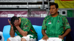 BUENOS AIRES, ARGENTINA - OCTOBER 17: Ronald Pacheco (R), head coach of Bolivia reacts the Women's Futsal 3rd Place match between Bolivia and Spain during the Buenos Aires Youth Olympics 2018 at Tecnopolis on October 17, 2018 in Buenos Aires, Argentina.  (Photo by Martin Rose - FIFA/FIFA via Getty Images)