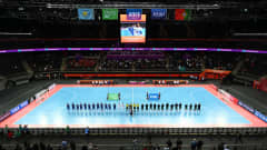 KAUNAS, LITHUANIA - SEPTEMBER 30: A general view as players and match officials line up prior to the FIFA Futsal World Cup 2021 Semi-Final match between Portugal and Kazakhstan at Kaunas Arena on September 30, 2021 in Kaunas, Lithuania. (Photo by Oliver Hardt - FIFA/FIFA via Getty Images)