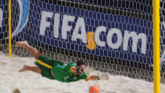 Mao of Brazil dives to make a save during the FIFA Beach Soccer World Cup Semi Final between Portugal and Brazil at Umm Suqeim on November 21, 2009 in Dubai, United Arab Emirates.