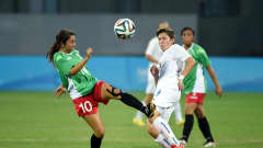 NANJING, CHINA - AUGUST 26:  Marianna Maldonado of Mexico battles with Maria Mikolajova of Slovakia during the 2014 FIFA Girls Summer Youth Olympic Football Tournament 3rd Place Playoff match between Mexico and Slovakia at Wutaishan Stadium on August 26, 2014 in Nanjing, China.  (Photo by Stanley Chou - FIFA/FIFA via Getty Images)