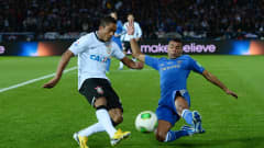 YOKOHAMA, JAPAN - DECEMBER 16:  Jorge Enrique of Corinthians is challenged by Ashley Cole of Chelsea during the FIFA Club World Cup Final Match between Corinthians and Chelsea at International Stadium Yokohama on December 16, 2012 in Yokohama, Japan.  (Photo by Mike Hewitt - FIFA/FIFA via Getty Images)