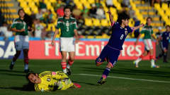 LIBERIA, COSTA RICA - MARCH 27:  Yui Hasegawa of Japan beats Emily Alvarado of Mexico to score her goal during the FIFA U-17 Women's World Cup Quarter Final match between Japan and Mexico at Edgardo Baltodano Briceno on March 27, 2014 in Liberia, Costa Rica.  (Photo by Jamie McDonald - FIFA/FIFA via Getty Images)