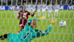 ABU DHABI, UNITED ARAB EMIRATES - DECEMBER 15: Miguel Calero of Club de Futbol Pachuca saves a penalty from Hugo of Al-Wahda Sports Club in the shoot-out only to see it ordered to be retaken during the FIFA Club World Cup match between Club de Futbol Pachuca and Al-Wahda Sports Club at Zayed Sports City on December 15, 2010 in Abu Dhabi, United Arab Emirates.  (Photo by Michael Regan - FIFA/FIFA via Getty Images)