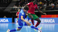 KAUNAS, LITHUANIA - SEPTEMBER 30: Douglas of Kazakhstan tackles Zicky of Portugal during the FIFA Futsal World Cup 2021 Semi-Final match between Portugal and Kazakhstan at Kaunas Arena on September 30, 2021 in Kaunas, Lithuania. (Photo by Angel Martinez - FIFA/FIFA via Getty Images)
