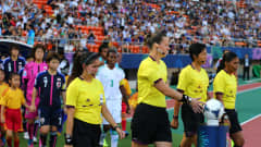 TOKYO, JAPAN - SEPTEMBER 08: Referee Margaret Domka of USA picks up the match ball the FIFA U-20 Women's World Cup Japan 2012, Third place match between Nigeria and Japan at National stadium on September 8, 2012 in Tokyo, Japan.  (Photo by Martin Rose - FIFA/FIFA via Getty Images)