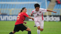 Han Hyang Suk of North Korea is challenged by Laura Gutierrez of Spain during the FIFA U17 Women's World Cup 3rd Place Playoff match between Spain and North Korea at the Hasely Crawford Stadium on September 25, 2010 in Port of Spain, Trinidad And Tobago. (Photo by Shaun Botterill - FIFA/FIFA via Getty Images)
