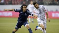 VANCOUVER, CANADA - APRIL 18:  Davide Chiumiento #20 of the Vancouver Whitecaps is fouled by Roger Espinoza #15 of Sporting Kansas City during the second half of MLS Soccer on April 18, 2012 at B.C. Place in Vancouver, British Columbia, Canada.  (Photo by Rich Lam/Getty Images)