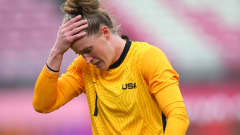 KASHIMA, JAPAN - AUGUST 02: Alyssa Naeher #1 of Team United States looks dejected after suffering an injury, forcing her to be substituted off during the Women's Semi-Final match between USA and Canada on day ten of the Tokyo Olympic Games at Kashima Stadium on August 02, 2021 in Kashima, Ibaraki, Japan. (Photo by Alex Livesey - FIFA/FIFA via Getty Images)