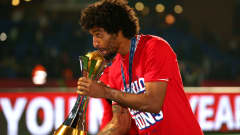 MARRAKECH, MOROCCO - DECEMBER 21:  Dante of FC Bayern Munchen kisses the FIFA Club World Cup after victory in the FIFA Club World Cup Final between FC Bayern Munchen and Raja Casablanca at Marrakech Stadium on December 21, 2013 in Marrakech, Morocco.  (Photo by Alex Livesey - FIFA/FIFA via Getty Images)