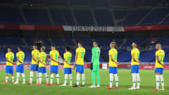 YOKOHAMA, JAPAN - AUGUST 07: Players of Team Brazil stand for the national anthem prior to the Men's Gold Medal Match between Brazil and Spain on day fifteen of the Tokyo 2020 Olympic Games at International Stadium Yokohama on August 07, 2021 in Yokohama, Kanagawa, Japan. (Photo by Alex Grimm - FIFA/FIFA via Getty Images)