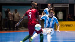 Alan Brandi (2nd L) of Argentina plays the ball past Joao Matos (L) of Portugal during the FIFA Futsal World Cup Semi-Final match between Argentina and Portugal at the Coliseo El Pueblo stadium on September 28, 2016 in Cali, Colombia.  (Photo by Alex Caparros - FIFA/FIFA via Getty Images)