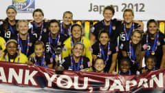 TOKYO, JAPAN - SEPTEMBER 08:  The USA team celebrate with the trophy after  winning the FIFA U-20 Women's World Cup Final match between USA and Germany at the National Stadium on September 8, 2012 in Tokyo, Japan.  (Photo by Ian Walton - FIFA/FIFA via Getty Images)