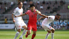GOYANG, SOUTH KOREA - JUNE 13: Son Heung-Min of South Korea competes for the ball with Joan Oumari of Lebanon during the FIFA World Cup Asian Qualifier 2nd round Group H match between South Korea and Lebanon at Goyang Stadium on June 13, 2021 in Goyang, South Korea. (Photo by Chung Sung-Jun/Getty Images)
