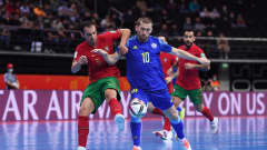 KAUNAS, LITHUANIA - SEPTEMBER 30: Chingiz Yessenamanov of Kazakhstan battles for possession with Fabio Cecilio of Portugal during the FIFA Futsal World Cup 2021 Semi-Final match between Portugal and Kazakhstan at Kaunas Arena on September 30, 2021 in Kaunas, Lithuania. (Photo by Alex Caparros - FIFA/FIFA via Getty Images)