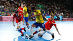 BUENOS AIRES, ARGENTINA - OCTOBER 18:  Igor Cherniavskii #7 of Russia challenges Wesley #10 of Brazil in the Men's Futsal Final match between Brazil and Russia during the Buenos Aires Youth Olympics 2018 at Tecn—polis on October 18, 2018 in Buenos Aires, Argentina.  (Photo by Kevin C. Cox - FIFA/FIFA via Getty Images)