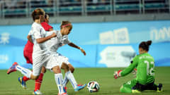 NANJING, CHINA - AUGUST 23: Denisa Mrazikova of Slovakia shields the ball for Denisa Mochnacka during the 2014 FIFA Girls Summer Youth Olympic Football Tournament Semi Final match between China and Slovakia at Wutaishan Stadium on August 23, 2014 in Nanjing, China.  (Photo by Stanley Chou - FIFA/FIFA via Getty Images)