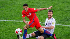 SAINT PETERSBURG, RUSSIA - JULY 02: Alexis Sanchez of Chile is tackled by Shkodran Mustafi of Germany during FIFA Confederations Cup Russia final match between Chile and Germany at Saint Petersburg Stadium on July 2, 2017 in Saint Petersburg, Russia. (Photo by Joosep Martinson - FIFA/FIFA via Getty Images)