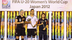 TOKYO, JAPAN - SEPTEMBER 08:  Julie Johnston of the USA wins the adidas Bronze Ball, Dzsenifer Marozsan of Germany wins the adidas Golden Ball and Hanae Shibata of Japan wins the adidas Silver Ball during the FIFA U-20 Women's World Cup Final match between USA and Germany at the National Stadium on September 8, 2012 in Tokyo, Japan.  (Photo by Ian Walton - FIFA/FIFA via Getty Images)