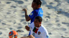 Alan of Portugal is challenged by Wilber Alvarado of El Salvador during the FIFA Beach Soccer World Cup 3rd Place Playoff match between El Salvador and Portugal at Stadium del Mare on September 11, 2011 in Ravenna, Italy. (Photo by Lars Baron - FIFA/FIFA via Getty Images)