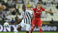 ABU DHABI, UNITED ARAB EMIRATES - DECEMBER 14: Amia Ekanga (L) of TP Mazembe Englebert duels for the ball with Andres D Allessandro of Sport Club Internacional during the FIFA Club World Cup semi final match between TP Mazembe Englebert and SC Internacional at Mohamed Bin Zayed Stadium on December 14, 2010 in Abu Dhabi, United Arab Emirates. (Photo by Jasper Juinen - FIFA/FIFA via Getty Images)