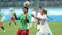 NANJING, CHINA - AUGUST 26:  Dayana Cazares of Mexico competes with Andrea Herbrikova of Slovakia during the 2014 FIFA Girls Summer Youth Olympic Football Tournament 3rd Place Playoff match between Mexico and Slovakia at Wutaishan Stadium on August 26, 2014 in Nanjing, China.  (Photo by Stanley Chou - FIFA/FIFA via Getty Images)