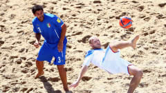 ESPINHO, PORTUGAL - JULY 19: Anatoliy Peremitin of Russia does a scissor kick next to Matteo Marrucci of Italy during the FIFA Beach Soccer World Cup Portugal 2015 Third Place match between Italy and Russia at Espinho Stadium on July 19, 2015 in Espinho, Portugal.  (Photo by Alex Grimm - FIFA/FIFA via Getty Images)