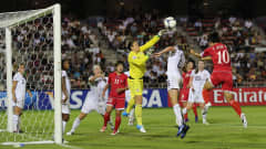 SAITAMA, JAPAN - AUGUST 31:  Yun Hyon Hi (R) of Korea DPR attempts a header only for the effort to be saved by goalkeeper  Bryane Heaberlin of the USA during the FIFA U-20 Women's World Cup Quarter-Final match between Korea DPR v USA at Komaba Stadium on August 31, 2012 in Saitama, Japan.  (Photo by Ian Walton - FIFA/FIFA via Getty Images)