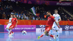 VILNIUS, LITHUANIA - SEPTEMBER 24: Ali Hassanzadeh of Iran scores their team's first goal during the FIFA Futsal World Cup 2021 Round of 16 match between Uzbekistan and Iran at Vilnius Arena on September 24, 2021 in Vilnius, Lithuania. (Photo by Alex Caparros - FIFA/FIFA via Getty Images)