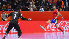 VILNIUS, LITHUANIA - SEPTEMBER 27: Adolfo Fernandez of Spain scores their team's first goal past Bebe of Portugal during the FIFA Futsal World Cup 2021 Quarter Final match between Spain and Portugal at Vilnius Arena on September 27, 2021 in Vilnius, Lithuania. (Photo by Alex Caparros - FIFA/FIFA via Getty Images)