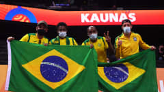 KAUNAS, LITHUANIA - OCTOBER 03: Fans of Brazil pose for a photo ahead of the FIFA Futsal World Cup 2021 3rd Place Playoff match between Brazil and Kazakhstan at Kaunas Arena on October 03, 2021 in Kaunas, Lithuania. (Photo by Alex Caparros - FIFA/FIFA via Getty Images)