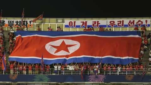 SAITAMA, JAPAN - AUGUST 31:  Korea DPR fans show their support during the FIFA U-20 Women's World Cup Quarter-Final match between Korea DPR and the USA at Komaba Stadium on August 31, 2012 in Saitama, Japan.  (Photo by Ian Walton - FIFA/FIFA via Getty Images)