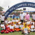 SANTIAGO DE LOS CABALLEROS, DOMINICAN REPUBLIC - AUGUST 22:  FIFA Chief Executive Officer of the FIFA Foundation Youri Djorkaeff (L), Dominican Republic Football Association (Fedofutbol) President Ruben Garcia (C) and children who participated in the FIFA Foundation Campus Program pose after receiving their diplomas during the closing ceremony of the activities at the Estadio Cibao Futbol Club, during the FIFA Foundation Campus event on August 22, 2021 in Santiago de los Caballeros, Dominican Republic. (Photo by Erika Santelices - FIFA/FIFA via Factstory)