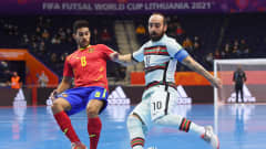 VILNIUS, LITHUANIA - SEPTEMBER 27: Ricardinho of Portugal is challenged by Adolfo Fernandez of Spain during the FIFA Futsal World Cup 2021 Quarter Final match between Spain and Portugal at Vilnius Arena on September 27, 2021 in Vilnius, Lithuania. (Photo by Alex Caparros - FIFA/FIFA via Getty Images)