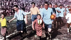 <label>Caption:</label>World Cup Final, 1930, Montevideo, Uruguay, Uruguay 4 v Argentina 2, Uruguay's veteran captain Jose Nasazzi and Argentine captain Manuel Ferreira lead their teams out to take part in the first ever World Cup Final (Photo by Popperfoto/Getty Images)