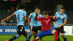 DUNEDIN, NEW ZEALAND - MAY 31: Ivan Saponjic of Serbia is challenged by Mauricio Lemos and Erick Cabaco of Uruguay during the FIFA U-20 World Cup New Zealand 2015 Group D match between Uruguay and Serbia at Otago Stadium on May 31, 2015 in Dunedin, New Zealand.  (Photo by Robert Cianflone - FIFA/FIFA via Getty Images)