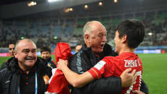 OSAKA, JAPAN - DECEMBER 13:  Zheng Long of Guangzhou Evergrande FC celebrates with coach Luiz Felipe Scolari at the end of the FIFA Club World Cup quarter final between the Club America and Guangzhou Evergrande FC at Osaka Nagai Stadium on December 13, 2015 in Osaka, Japan.  (Photo by Shaun Botterill - FIFA/FIFA via Getty Images)