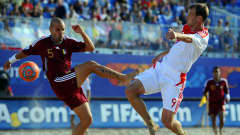RAVENNA, ITALY - SEPTEMBER 06: Pablo Ferreira of Venezuela challenges Egor Shaykov of Russia during the FIFA Beach Soccer World Cup Group C match between Venezuela and Russia at Stadium del Mare on September 6, 2011 in Ravenna, Italy. (Photo by Lars Baron - FIFA/FIFA via Getty Images)