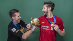 DOHA, QATAR - DECEMBER 21: Adrian and Adam Lallana of Liverpool pose with the Club World Cup trophy after the FIFA Club World Cup Qatar 2019 Final match between Liverpool and CR Flamengo at Khalifa International Stadium on December 21, 2019 in Doha, Qatar. (Photo by David Ramos - FIFA/FIFA via Getty Images)