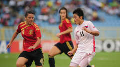 Kim Su Gyong of North Korea takes on Ivana Andres of Spain during the FIFA U17 Women's World Cup 3rd Place Playoff match between Spain and North Korea at the Hasely Crawford Stadium on September 25, 2010 in Port of Spain, Trinidad And Tobago. (Photo by Shaun Botterill - FIFA/FIFA via Getty Images)