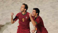 DUBAI, UNITED ARAB EMIRATES - NOVEMBER 22: Ze Maria of Portugal celebrates scoring with team mate Bruno Novo during the FIFA Beach Soccer World Cup 3rd Place Playoff match between Portugal and Uruguay on November 22, 2009 in Dubai, United Arab Emirates. (Photo by Michael Regan - FIFA/FIFA via Getty Images)