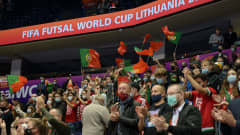 VILNIUS, LITHUANIA - SEPTEMBER 27: Fans of Portugal show support for their team prior to the FIFA Futsal World Cup 2021 Quarter Final match between Spain and Portugal at Vilnius Arena on September 27, 2021 in Vilnius, Lithuania. (Photo by Alexander Scheuber - FIFA/FIFA via Getty Images)