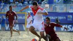 RAVENNA, ITALY - SEPTEMBER 06: Dmitry Shishin of Russia is challenged by Pedro Romero of Venezuela during the FIFA Beach Soccer World Cup Group C match between Venezuela and Russia at Stadium del Mare on September 6, 2011 in Ravenna, Italy. (Photo by Lars Baron - FIFA/FIFA via Getty Images)