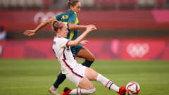 KASHIMA, JAPAN - JULY 27: Becky Sauerbrunn #4 of Team United States battles for possession with Kyah Simon #17 of Team Australia during the Women's Football Group G match between United States and Australia during the Tokyo 2020 Olympic Games at Kashima Stadium on July 27, 2021 in Kashima, Japan. (Photo by Hector Vivas - FIFA/FIFA via Getty Images)