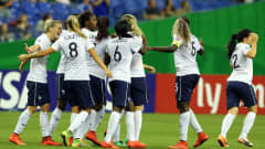 Team members of France celebrate their 3rd goal during the FIFA U-20 Women's World Cup 2014 3rd place playoff match between Korea DPR and France at Olympic Stadium on August 24, 2014 in Montreal, Canada.  (Photo by Martin Rose - FIFA/FIFA via Getty Images)