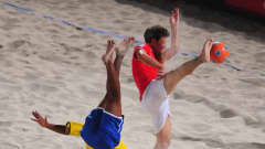 DUBAI, UNITED ARAB EMIRATES - NOVEMBER 22: Andre of Brazil scores the first goal of the game as Mo Jaeggy of Switzerland fails to block during the FIFA Beach Soccer World Cup Final between Brazil and Switzerland at Umm Suqeim beach on November 22, 2009 in Dubai, United Arab Emirates. (Photo by Mike Hewitt - FIFA/FIFA via Getty Images)